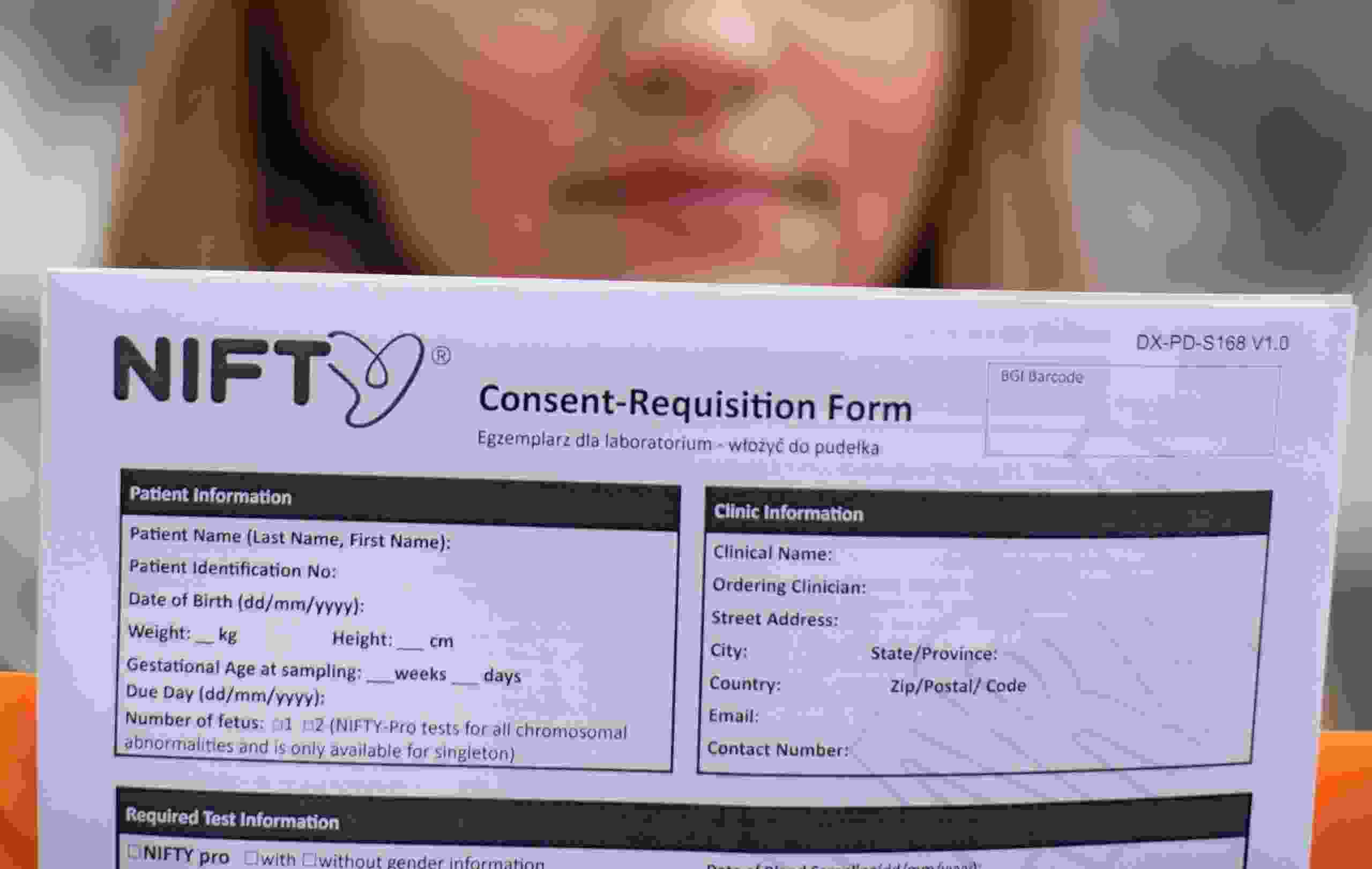Office administrator Emilia, who requests that only her first name be used, and had taken Chinese gene firm BGI Group's NIFTY prenatal test, holds a blank copy of the test's consent form in Warsaw, Poland, March 30, 2021.
